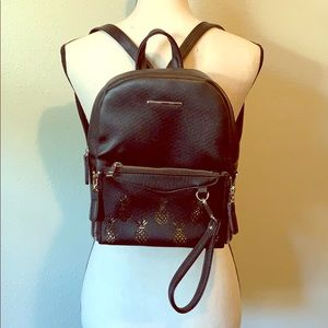 Black backpack with zip off pineapple pouch